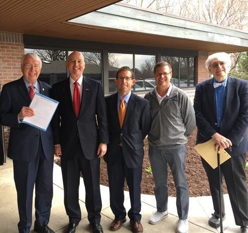 State Senator Merv Riepe, Governor Pete Ricketts, Dr. Todd Johnson, Dr. Joel Bessmer, and Dr. Steve Lazoritz at the 2018 Direct Primary Care Pilot Program Act signing ceremony.